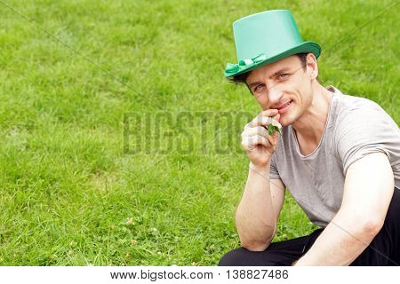 handsome young man in a green hat - holiday St. Patrick