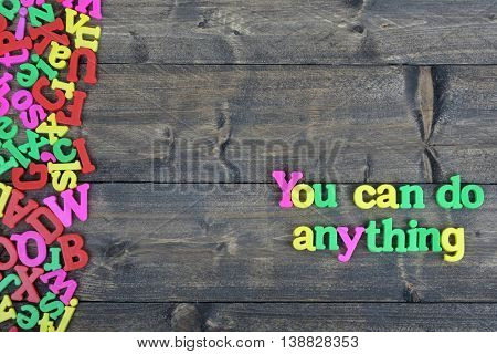 You can do anything word on wooden table
