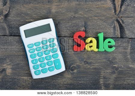 Sale word on wooden table
