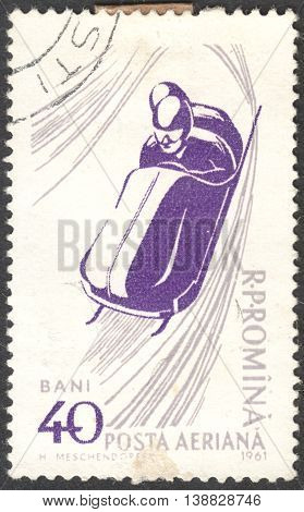 MOSCOW RUSSIA - CIRCA JANUARY 2016: a post stamp printed in ROMANIA shows a bobsled the series