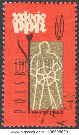 MOSCOW RUSSIA - JANUARY 2015: a post stamp printed in POLAND shows a worker the series
