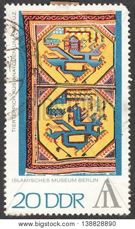 MOSCOW RUSSIA - CIRCA FEBRUARY 2016: a post stamp printed in DDR shows Tapestry with Animal Design the series