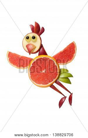 Flying chicken made of grapefruit on white background