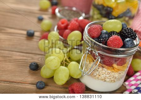 Muesli with berries on wooden background close up