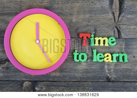 Time to learn word on wooden table
