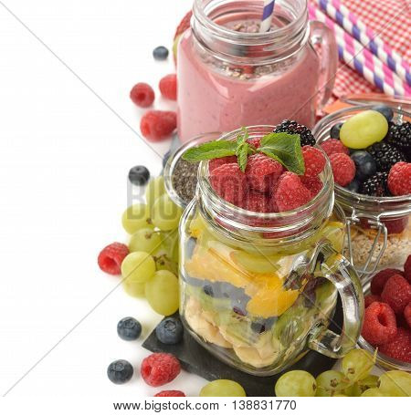 Fruit salad in a jar on a white background