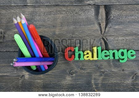 Challenge word on wooden table