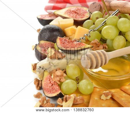 Cheese with grapes figs and honey on white background