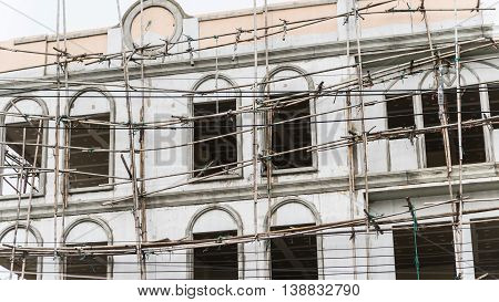 restoration facade of tall house scaffolding construction