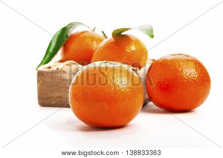 Ripe mandarines Tangerines with leaves on a white background. Tangerines