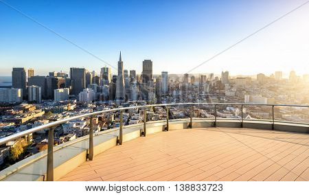 cityscape and skyline of san francisco at sunrise on view from empty street