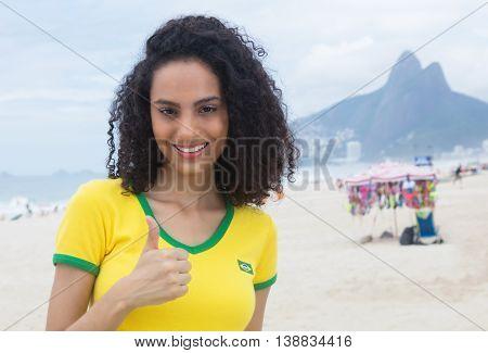 Beautiful brazilian sports fan with curly hair at Rio de Janeiro in the summer