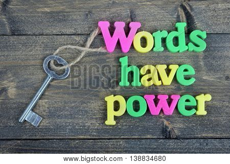 Words have power word on wooden table