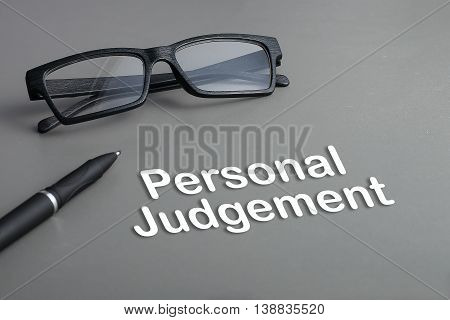 Concept : Personal Judgement. business concept. pen and glasses
