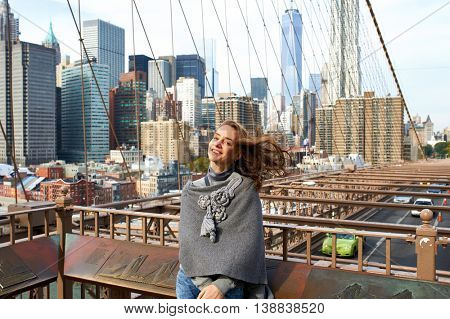 Woman in New York City with Manhattan skyline at background