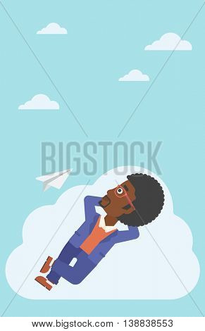 An african-american businessman lying on a cloud and looking at flying paper plane. Businessman relaxing on a cloud. Vector flat design illustration. Vertical layout.