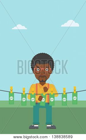 An african-american businessman drying banknotes on the clothesline on the background of blue sky. Man loundering money. Vector flat design illustration. Vertical layout.