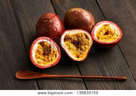 Passion fruits on dark wooden table