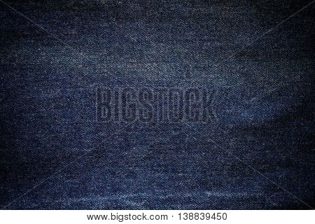 Denim jeans texture background with vignette border