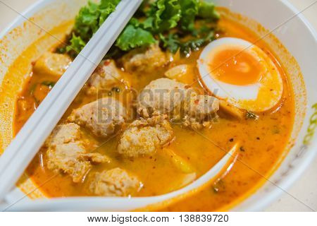 Hot And Sour Soup And Meatball Boiled Egg In Condensed Water, Thai Traditional Food.