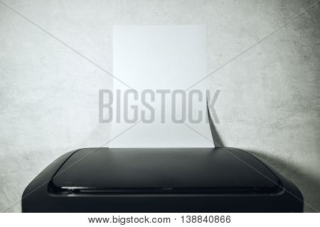 Office desktop laser printer with blank paper of A4 or letter size as copy space coming out from output tray selective focus