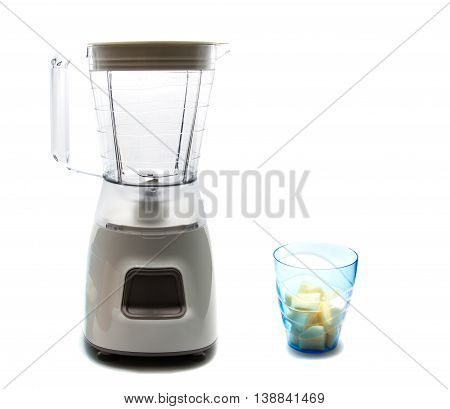 electric blender as kitchen equipment and a cup of slide apple isolated on white