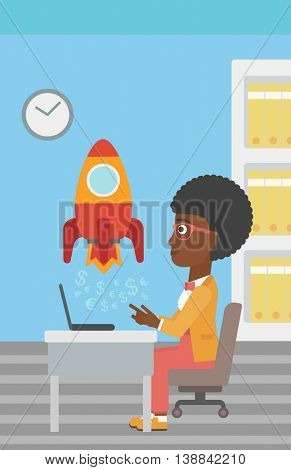 An african-american business woman sitting at the table and looking at a business start up rocket taking off. Business start up concept. Vector flat design illustration. Vertical layout.