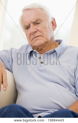 Senior Man Sitting On Couch