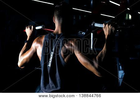 Fit Happy Using Weights Machine For Arms At The Gym