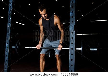 Weightlifter Lifting Barbells At Gym. Deadlift Exercise