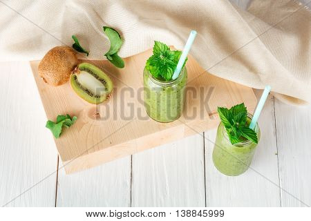 Fruit and vegetable smoothies out of kiwi arugula. Top view