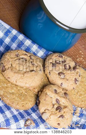 closeup of a fresh milk and cookies with chocolate,
