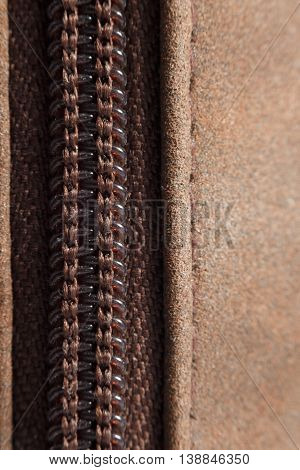 close up detail zipper on brown case