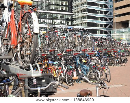 The Hague Netherlands - July 6 2016: crowded two level bicycle storage for commuters at The Hague central train station.