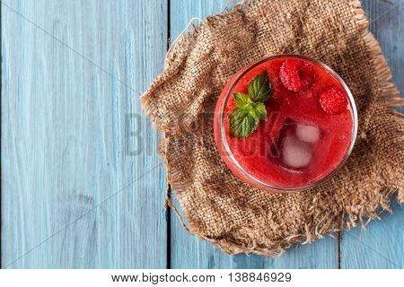 glass of berry smoothie of strawberries and raspberries