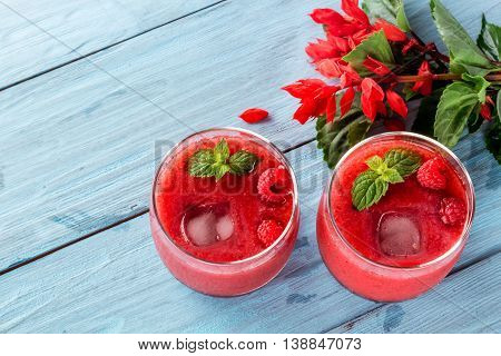 two glasses of berry smoothie of strawberries and raspberries