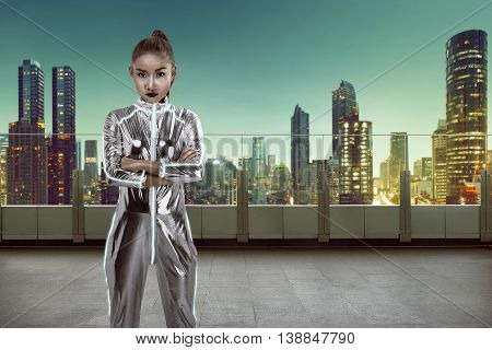 Woman Wearing Latex Jumpsuit Posing On Building Rooftop