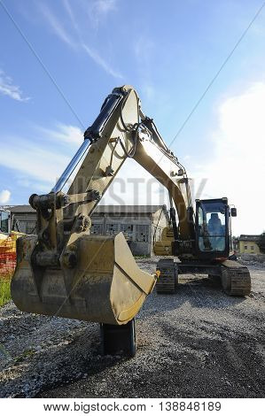 Excavator Bulldozer At Construction Site.