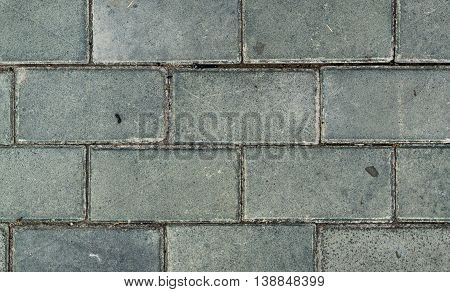 Pavement, stone pavement texture, sidewalk, pavement top view, close up, abstract background of new cement blocks