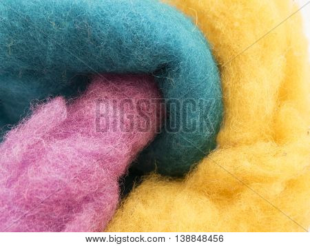 Multicolored wool for felting purple, blue and yellow