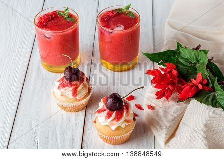 cupcakes with cherries berry smoothie of strawberries and raspberries