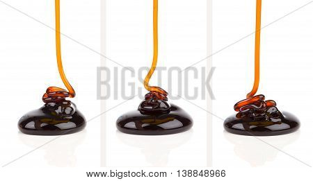 pouring caramel sauce isolated on white background