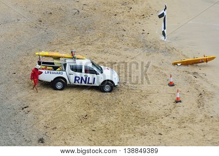 Newquay Cornwall United Kingdom - July 01 2016: Royal National Lifeboat institute vehicle on surfers beach
