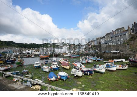 Mevagissey Cornwall United Kingdom - July 02 2016: Harbour of small Cornish fishing village with fishing boats