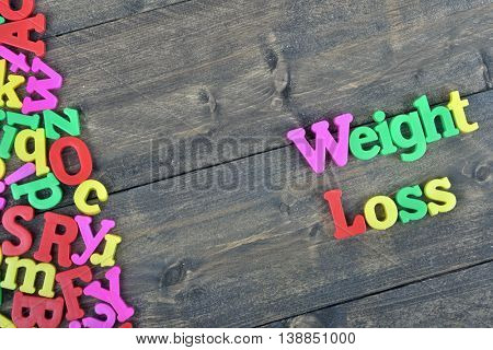 Weight loss word on wooden table