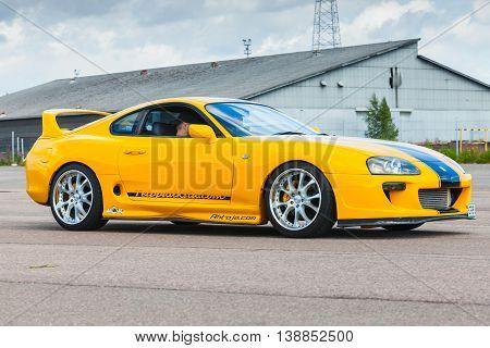 Yellow Sporty Toyota Supra A80