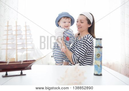 Mother And Son Playing With The Ship.
