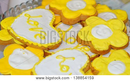 Heart cookies background, yellow and white cookies