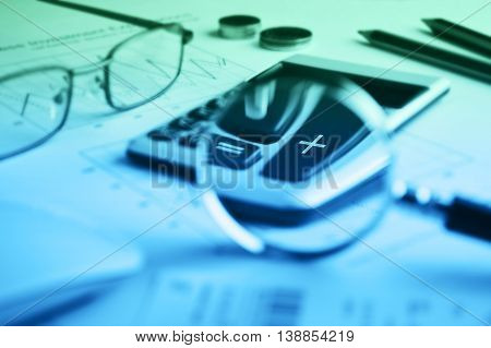 Calculator button plus and magnifying glass on graph paper background Success business concept