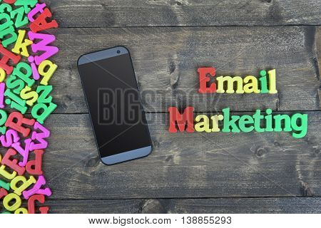 Email Marketing word on wooden table